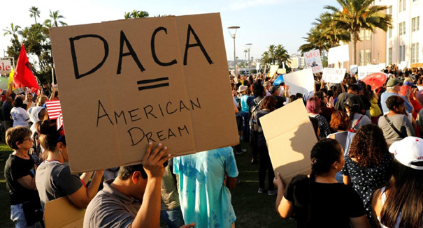 Federal judge blocks Trump's move to end DACA