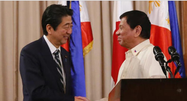Abe pledges $8 billion in peace to Philippines
