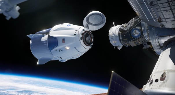 A SpaceX capsule has successfully docked with the International Space Station